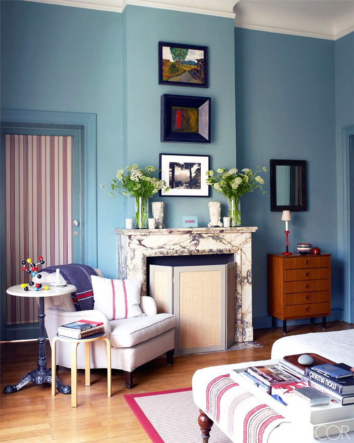 Eclectic bedroom with blue walls and marble fireplace via @thouswellblog