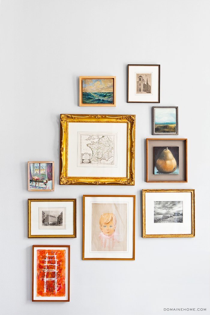 Mixed gallery wall with different styles and frames on Thou Swell @thouswellblog