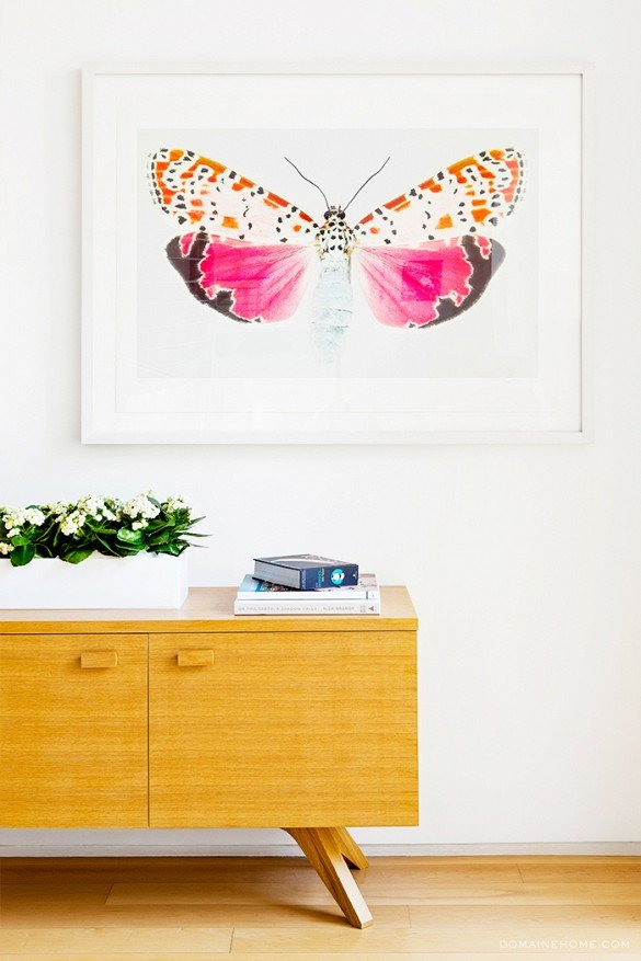 Butterfly art print above modern walnut sideboard on Thou Swell @thouswellblog