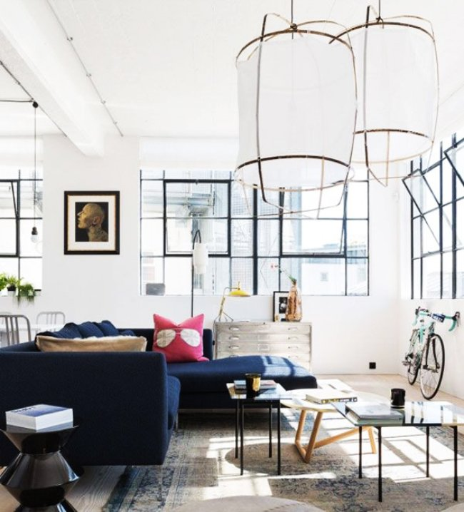 Sun-filled living room with over-sized lantern pendants and contemporary blue sectional. #OneRoomChallenge