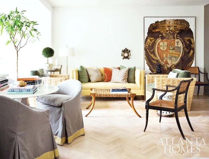 A bright, light-filled living room with worldly touches and antique accents in the pied-à-terre of architect Bill Ingram.