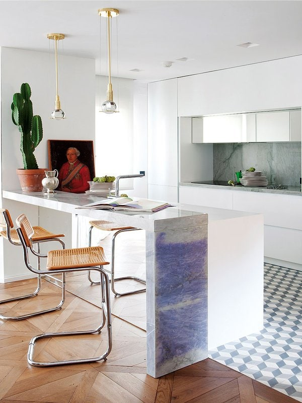 Luxe materials bring drama to this sleek Spanish kitchen.