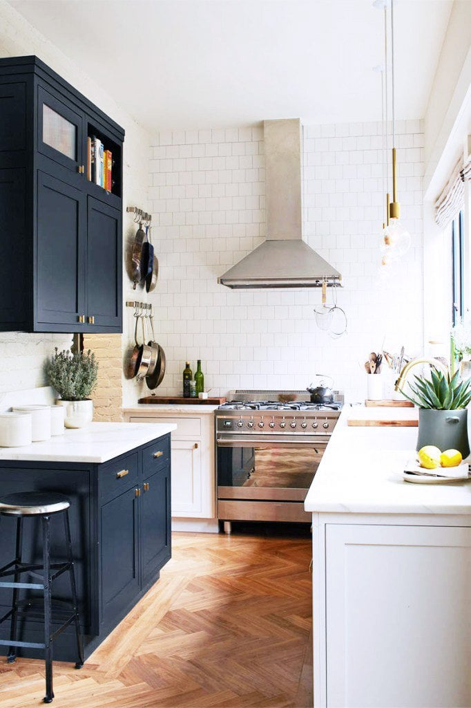Classic black and white galley-style kitchen.