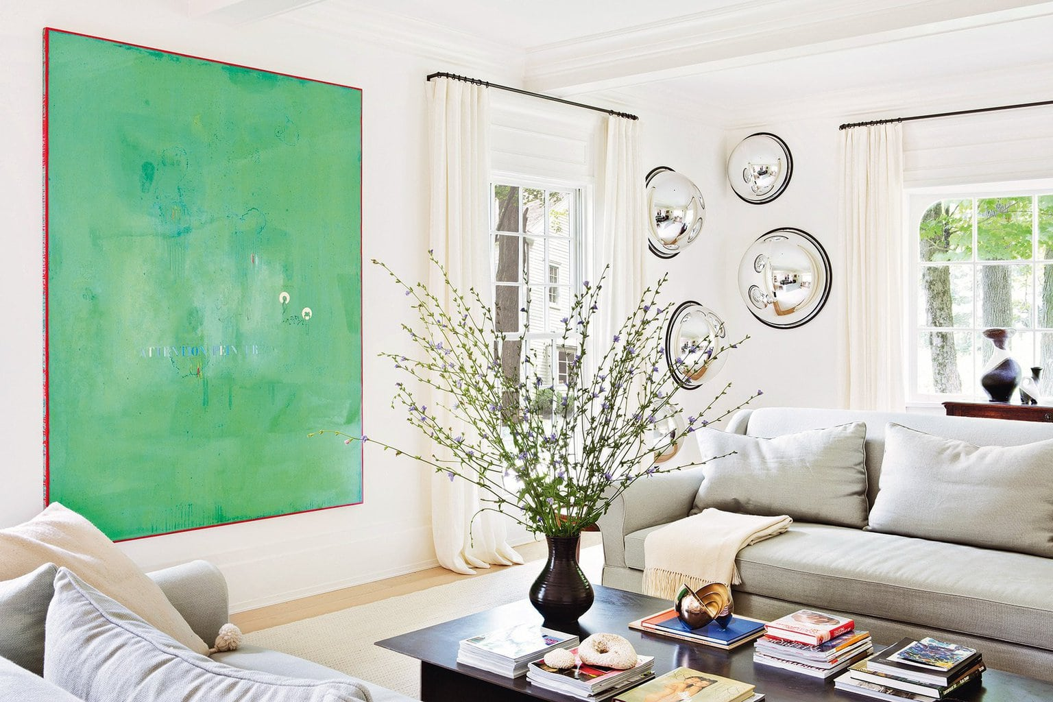 Contemporary living room with bold modern art in a farmhouse in New York via @thouswellblog