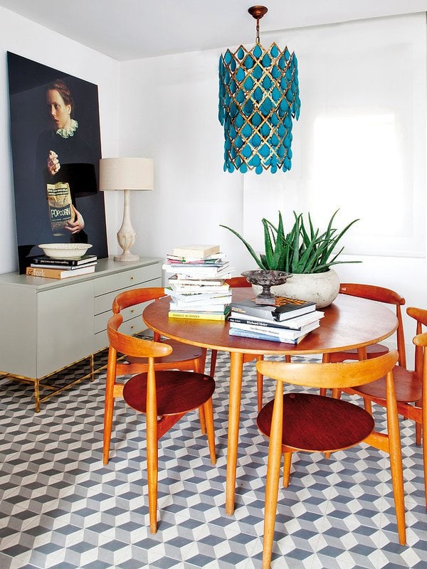 Mid-century dining chairs add warmth to this modern dining room.