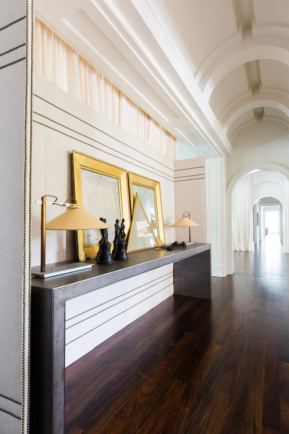 Gold and white hallway in a Nashville mansion on @thouswellblog