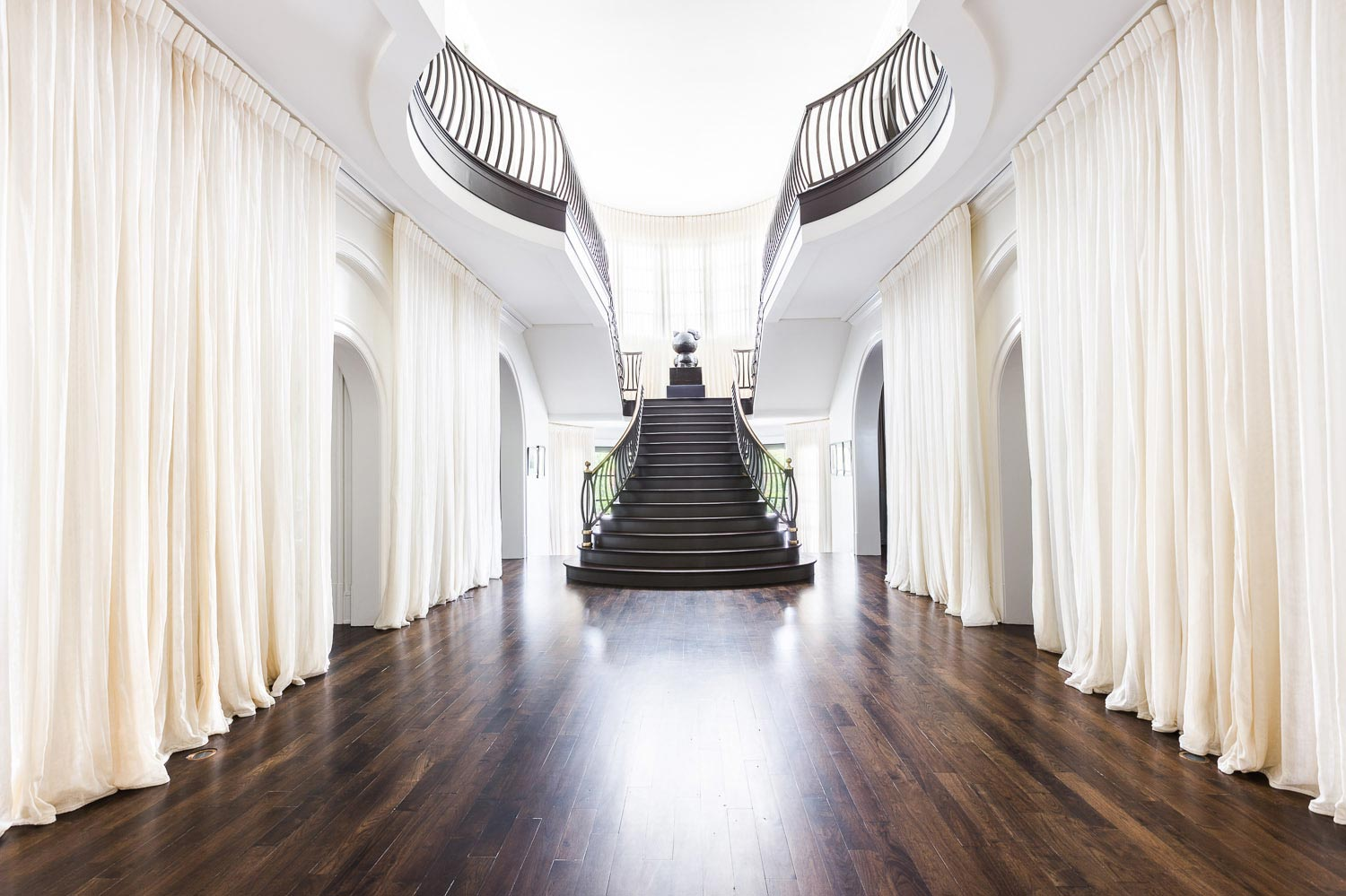 Graceful foyer with long curtains to soften the huge space on @thouswellblog