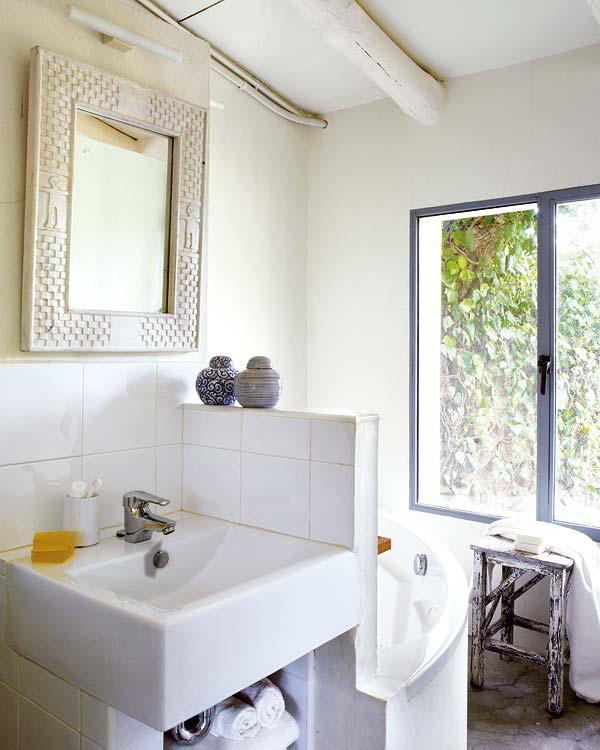 A serene bathroom with a lush view.