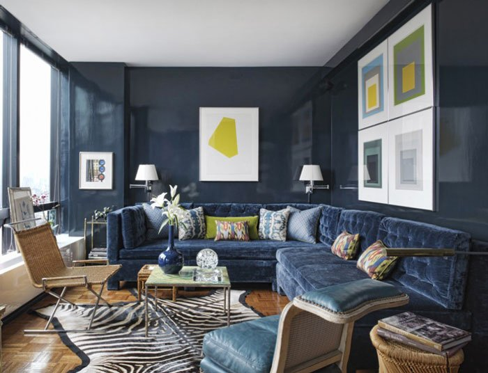 Handsome neo-trad living room with navy lacquer walls and tufted velvet sectional.