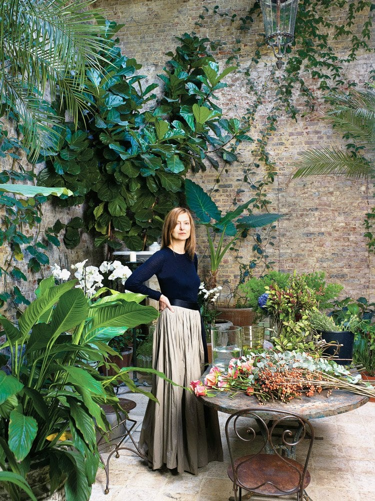 Rose Uniacke in her lush patio at her home in London.