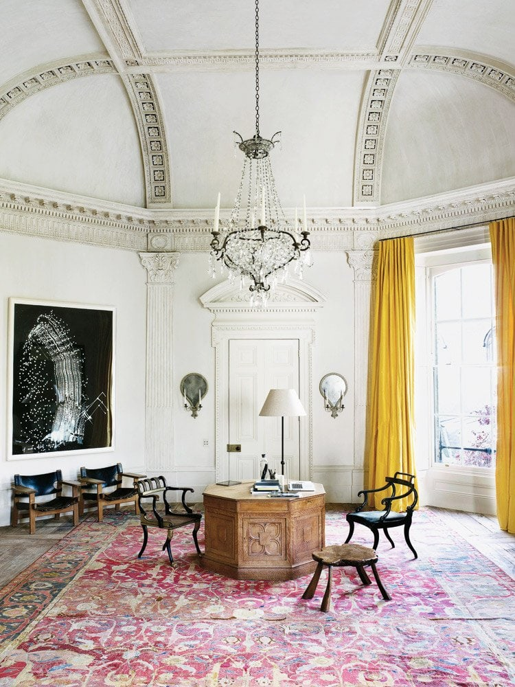 Soaring ceilings and ornate architecture in a elegant London home office.