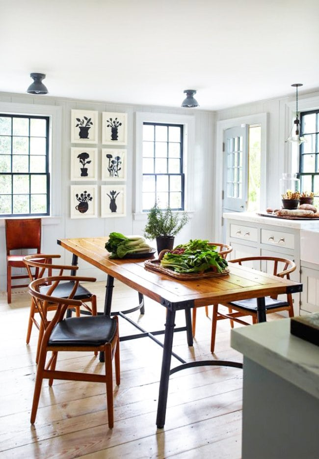 A coastal kitchen in Sag Harbor with a farmhouse table and shaker cabinets.