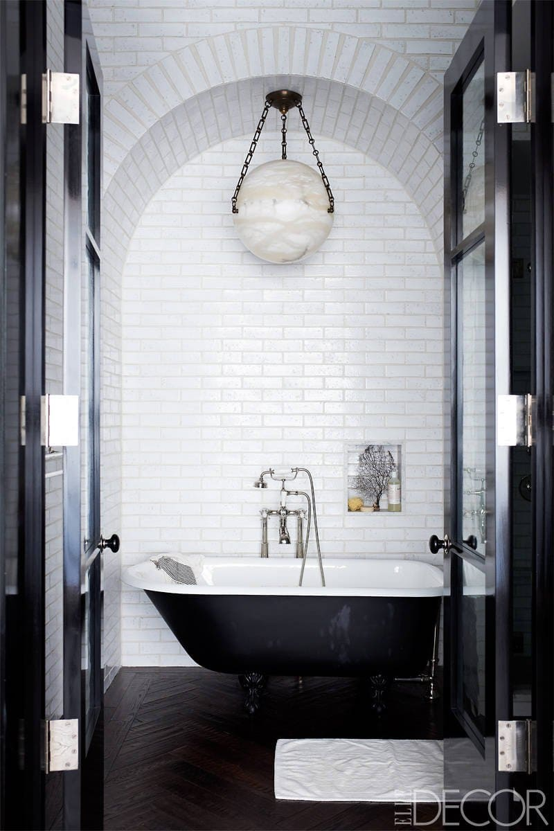 High-drama, black and white free-standing bathtub bathroom inspiration