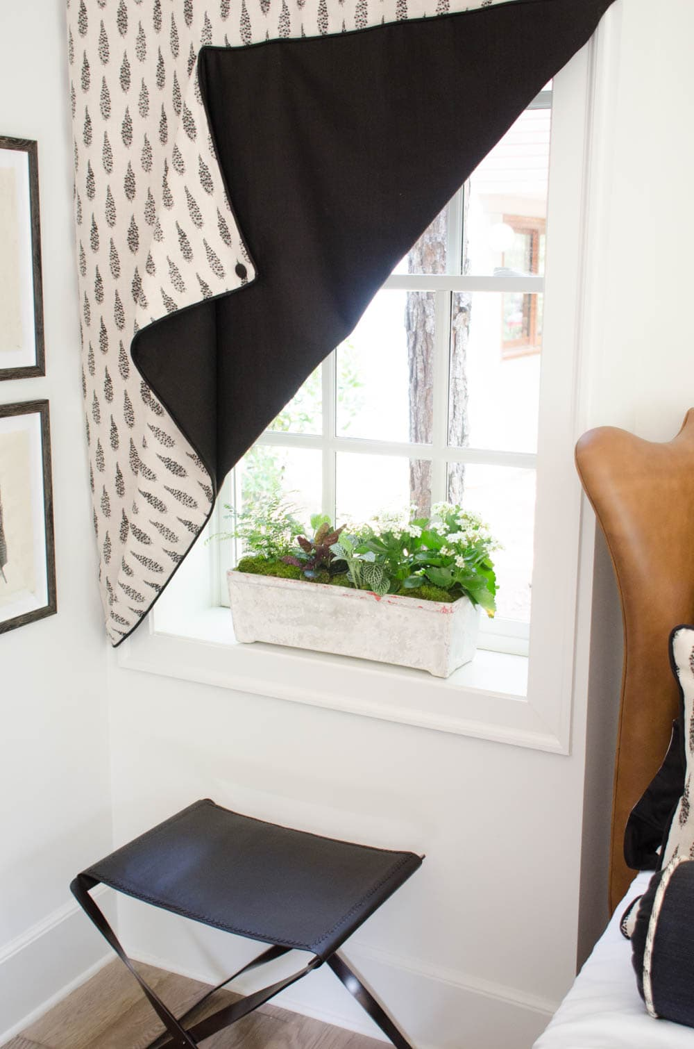 Triangle drapery in black and white bedroom