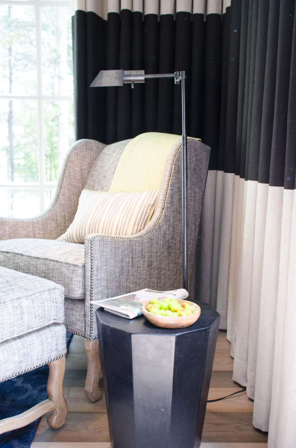 Bedroom corner with floor-to-ceiling curtains with wide black stripe