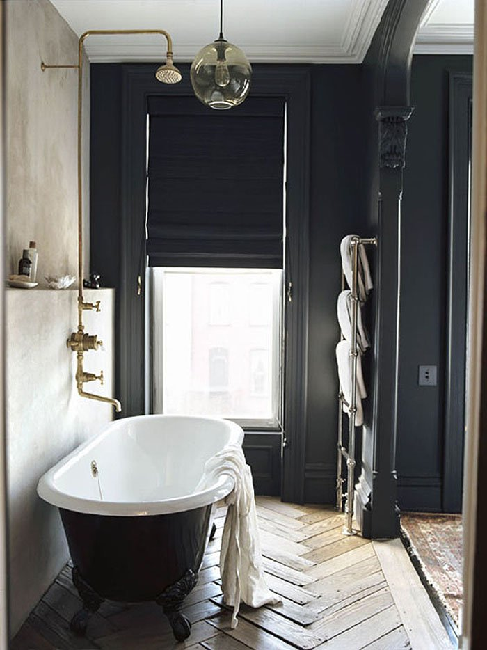 Moody charcoal free-standing tub bathroom inspiration in Jenna Lyons' home on Thou Swell #bathroom #bathtub #bath #jennalyons #homedesign #bathroomdesign