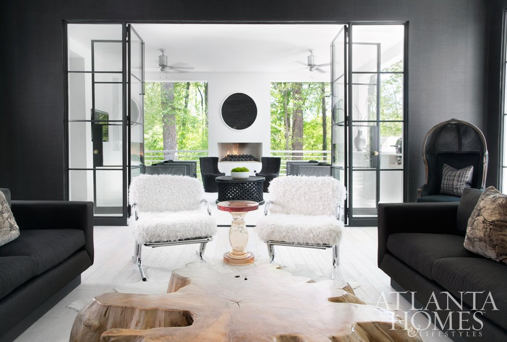 Modern black living room with bright white porch.