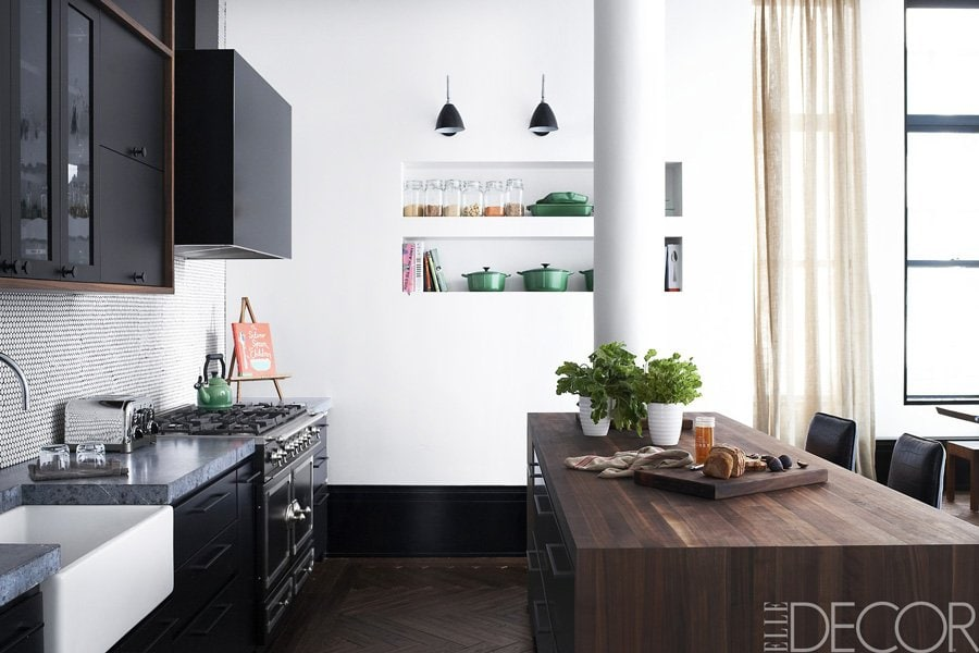 The sleek black and white kitchen of Coldplay guitarist Johnny Buckland.