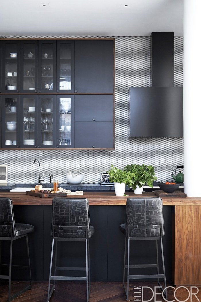 The sleek black and white kitchen of Johnny Buckland's cool Manhattan pad.