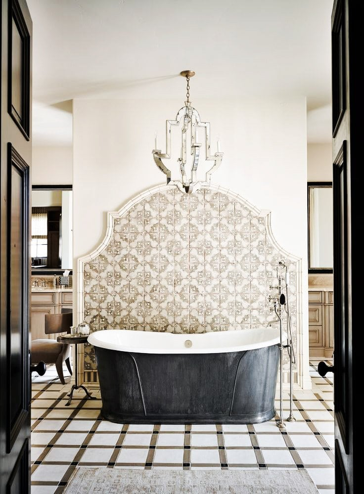 Eclectic tiles frame a free-standing tub, bathroom inspiration