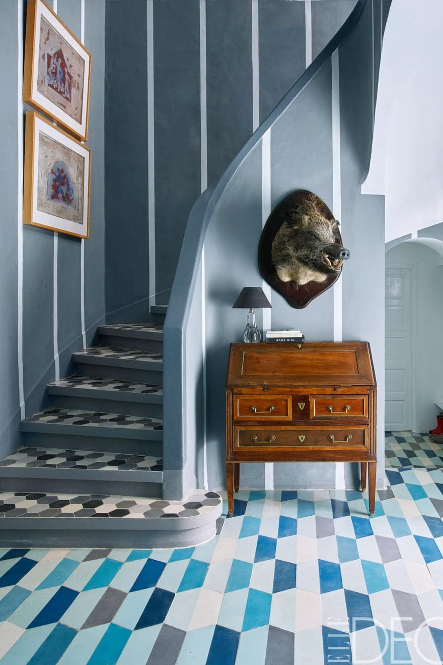 The dramatic blue patterned entry in the home of Moroccan tile designers.