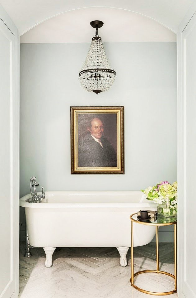 Simple moody traditional bathroom with free-standing tub