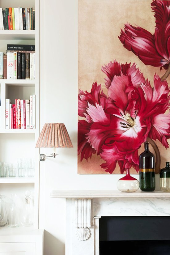 Pink flower painting above a marble fireplace in a townhouse designed by Flora Soames