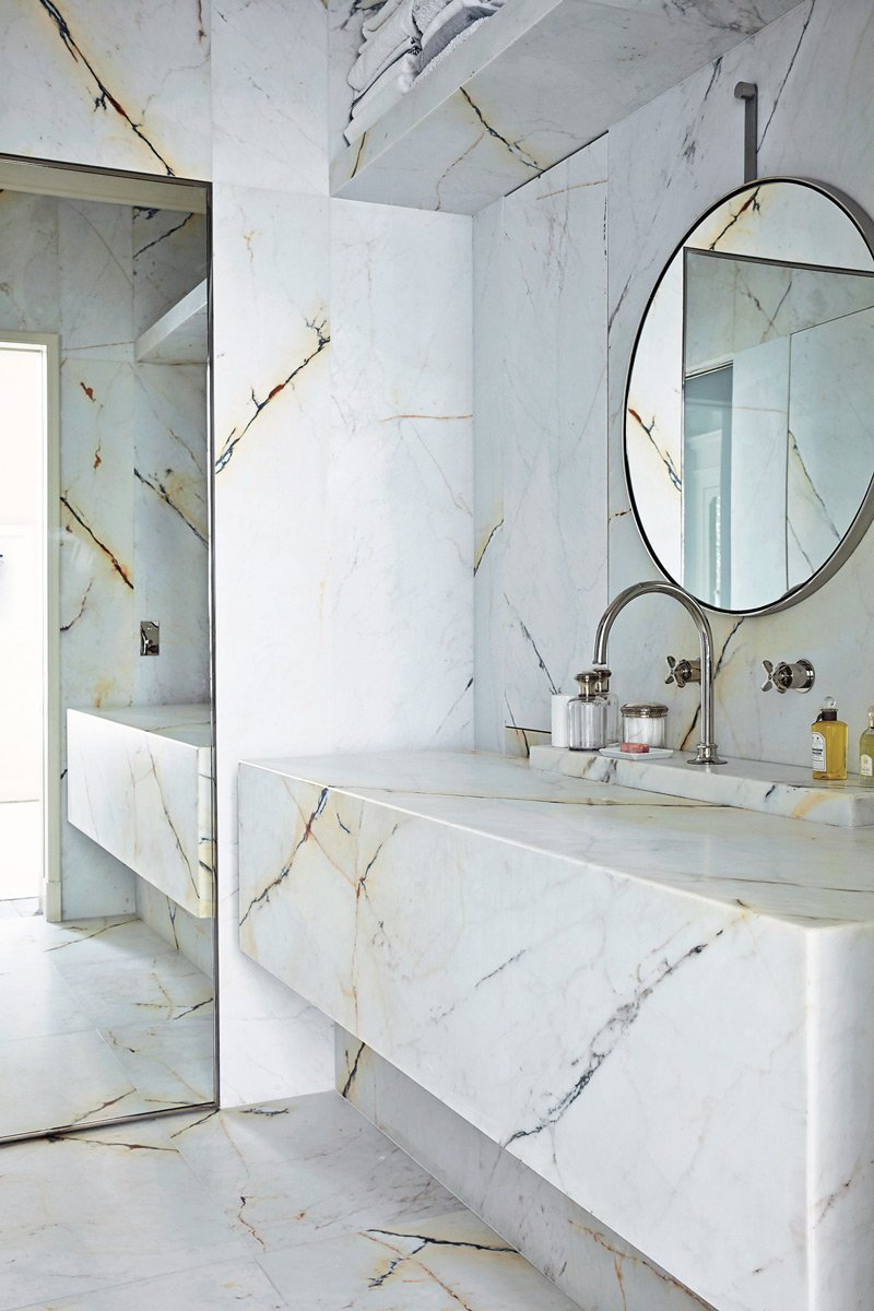 Veined marble in a sleek, modern bathroom.