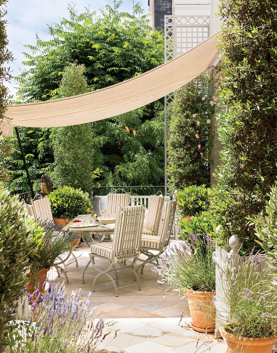 The lush terrace of a historic French apartment on @thouswellblog.