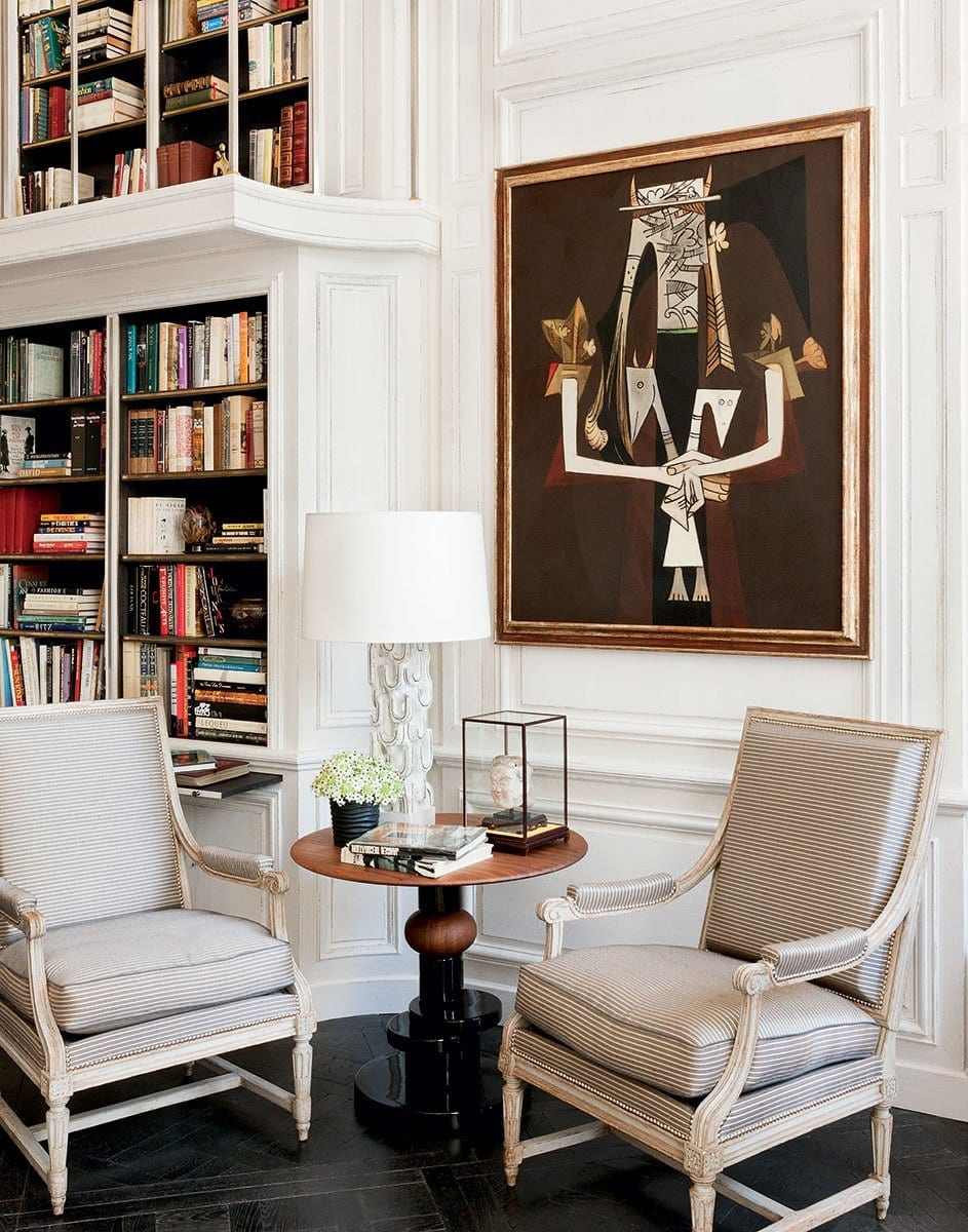 The living room in a historic French apartment designed by François Catroux with a fresh mix of modern and traditional elements on @thouswellblog.