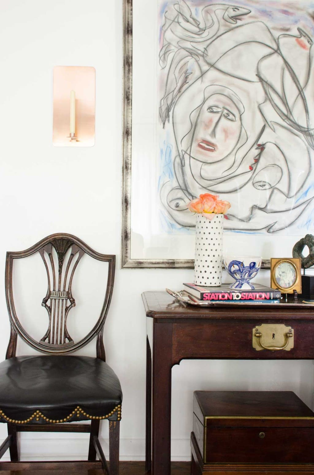 Vignette from @thouswellblog's living room makeover, Thorton Dial painting
