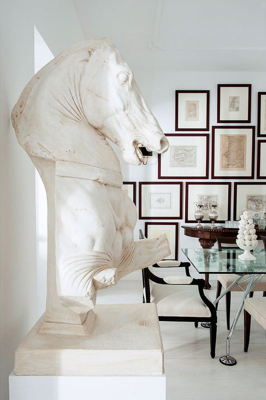 Horse bust statue in a modern dining room with gallery wall via @thouswellblog