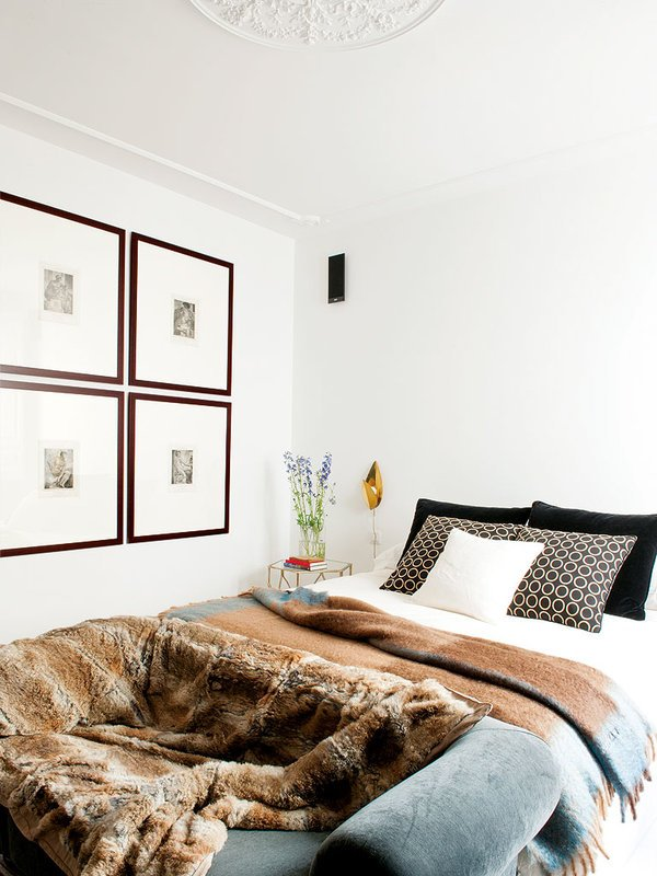 Simple luxe bedroom in a Spanish apartment with fur throw via @thouswellblog