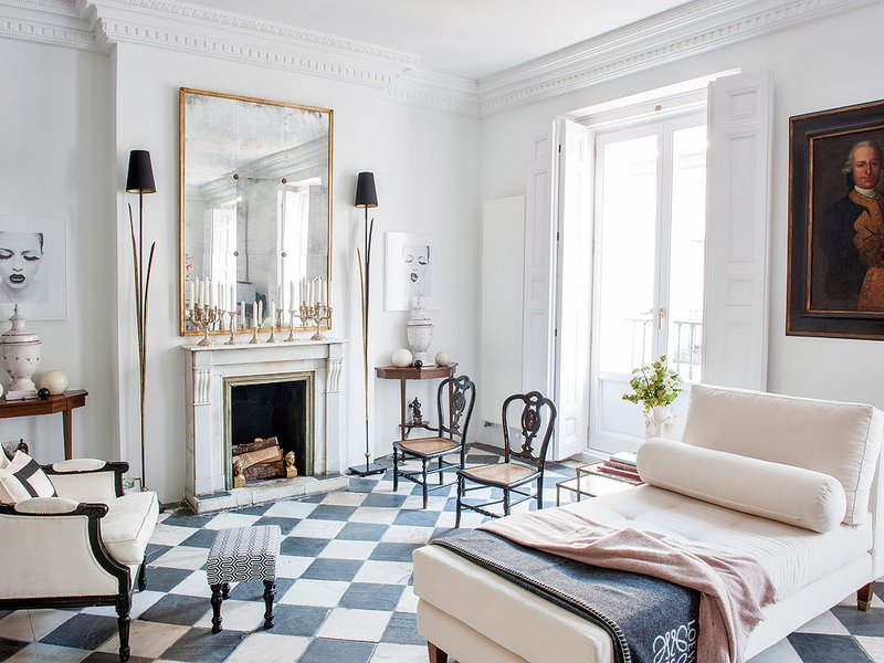Graphic checkerboard floor in the serene living room of a historic apartment via @thouswellblog.