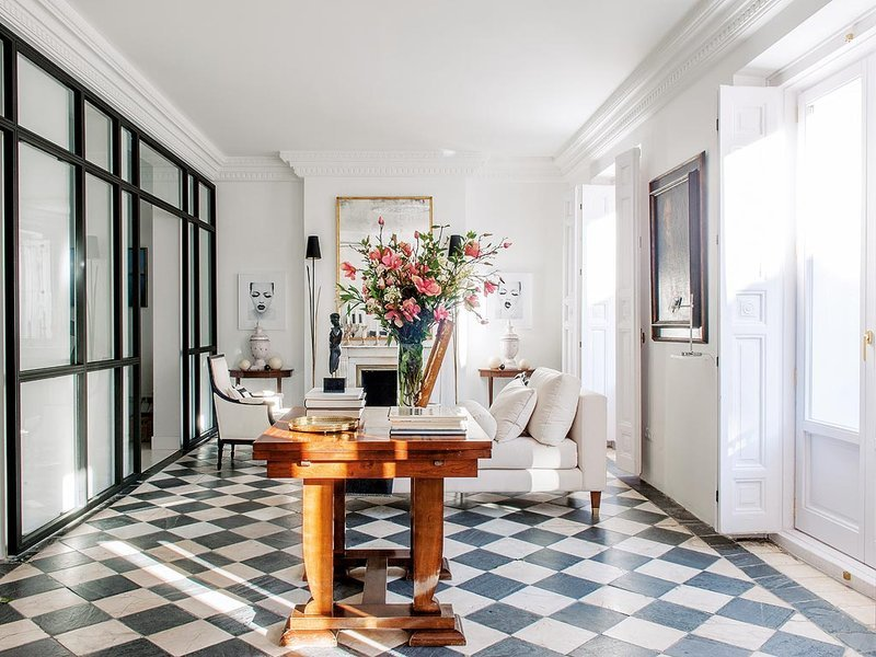 The checkerboard floor was kept intact in this historic apartment's renovation via @thouswellblog