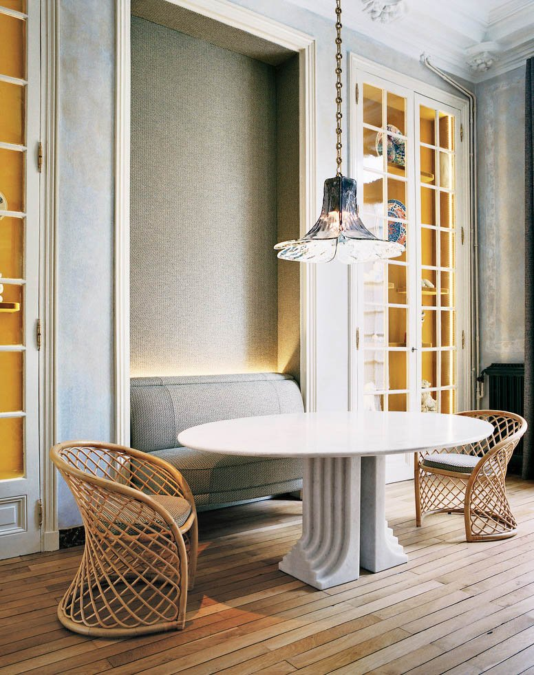 A bespoke modern dining room with lit china cabinets and a marble pedestal table on @thouswellblog