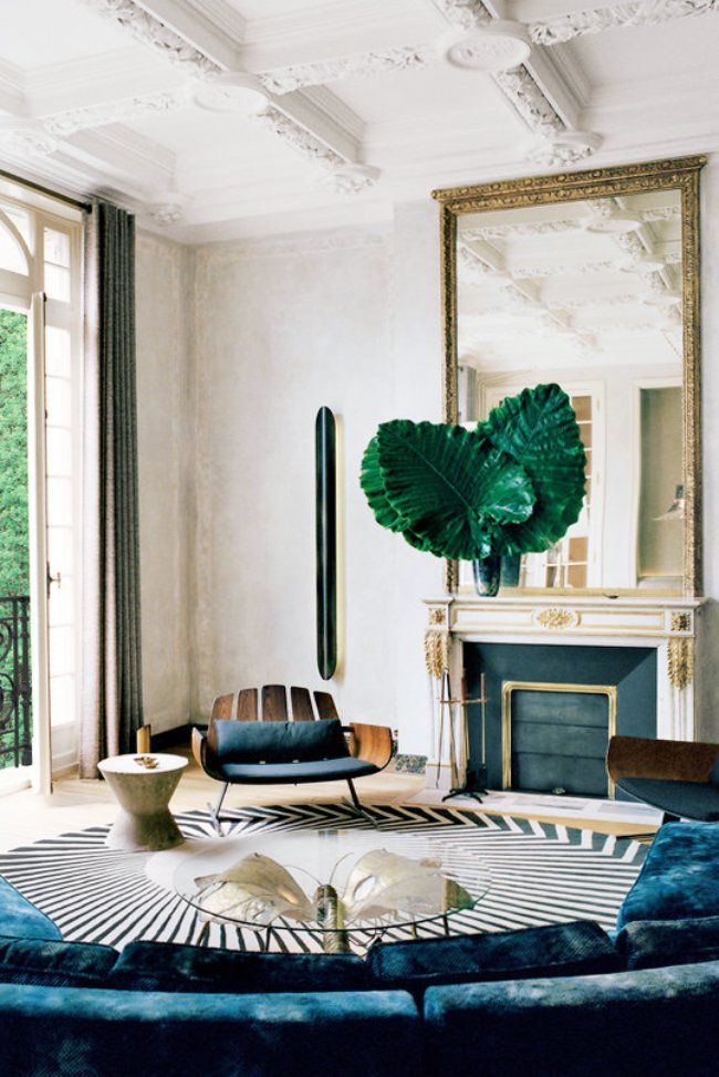 A sophisticated modern living room in an ornate Parisian apartment on @thouswellblog