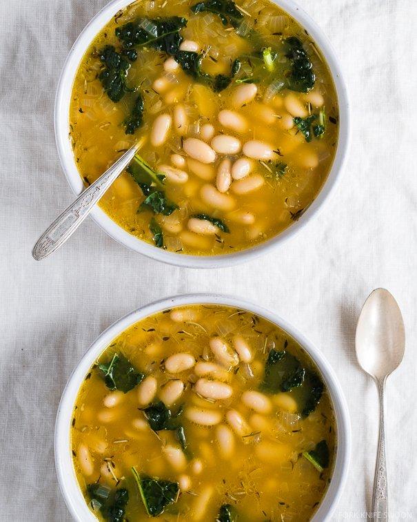 Lemon kale white bean soup on @thouswellblog via Fork Knife Swoon