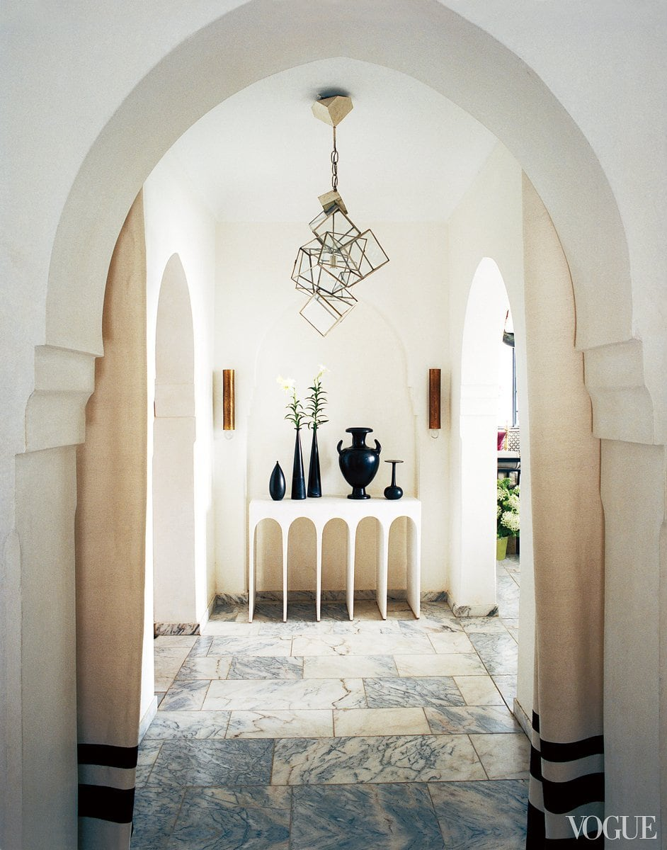 Elegant console and cubist light in a Moroccan entry on @thouswellblog