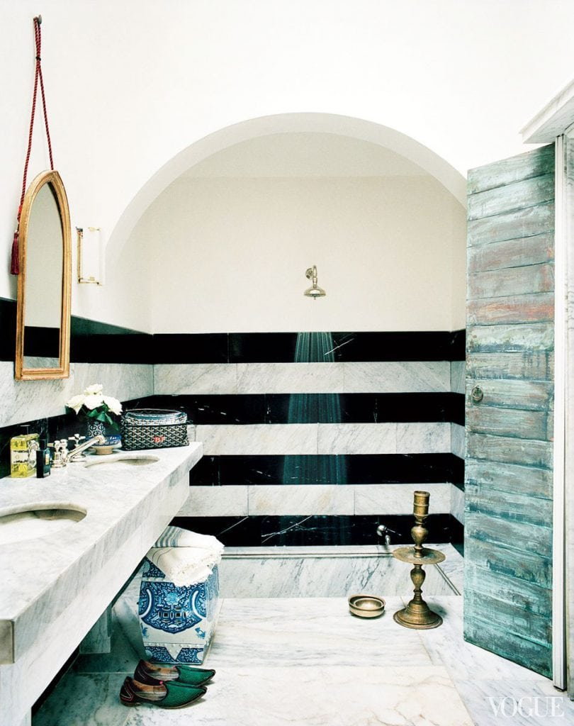 Striped marble bathroom in a Moroccan home on Thou Swell #marble #marblebathroom #bathroom #bathroomtile #tiling #bathroomdesign #stripes #stripedmarble #stripedwall #stripedbathroom #interiordesign