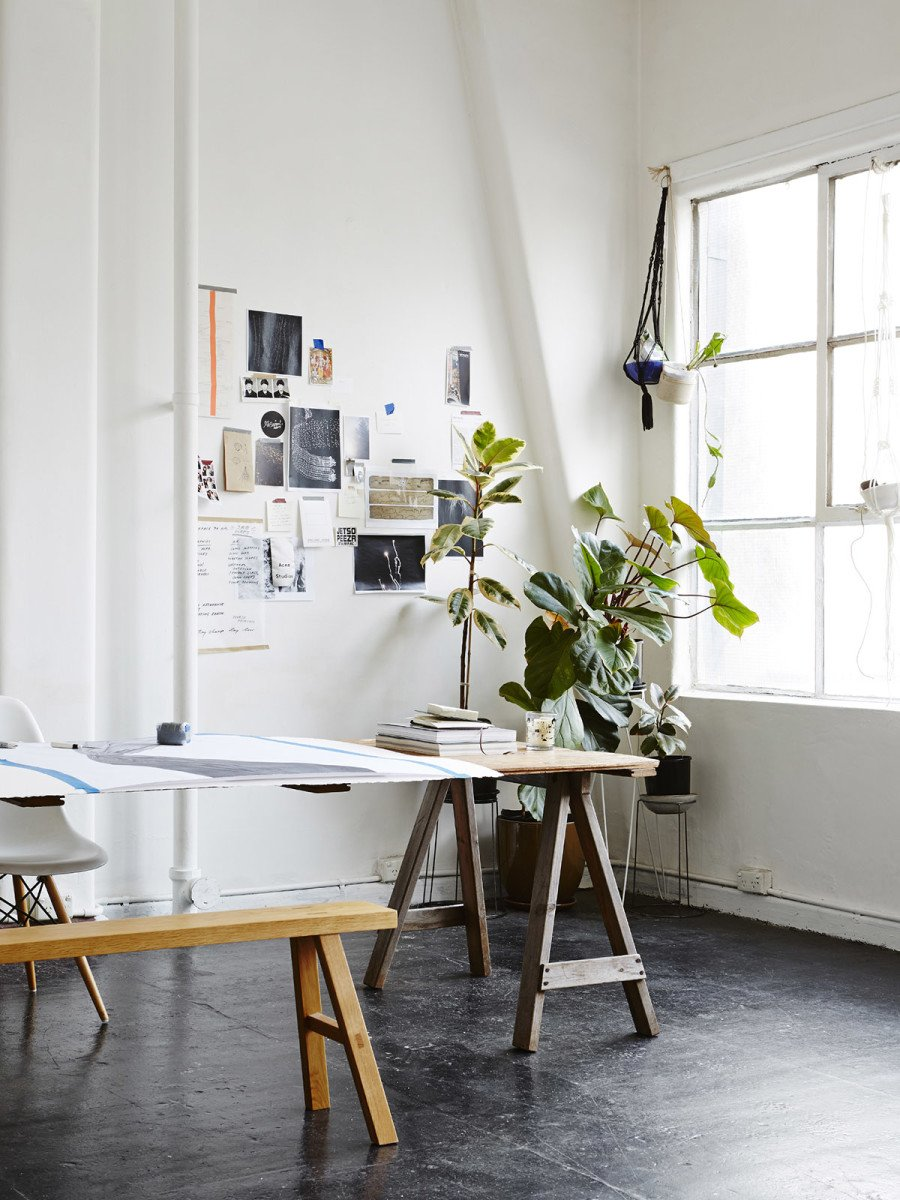 Bright, open artist studio with indoor plants and inspiration wall on @thouswellblog