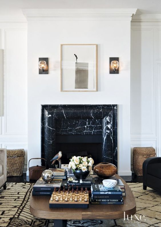 Black marble fireplace via @thouswellblog