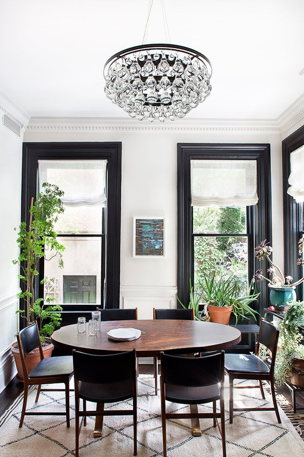Black and white dining room with moroccan rug, leather chairs, and indoor plants via @thouswellblog