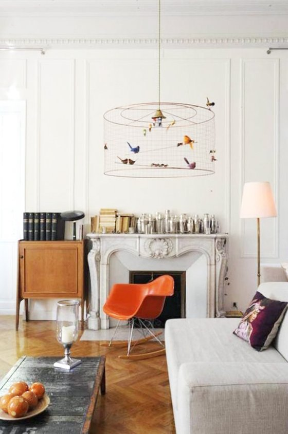 Living room with orange Eames rocker and bird chandelier via @thouswellblog