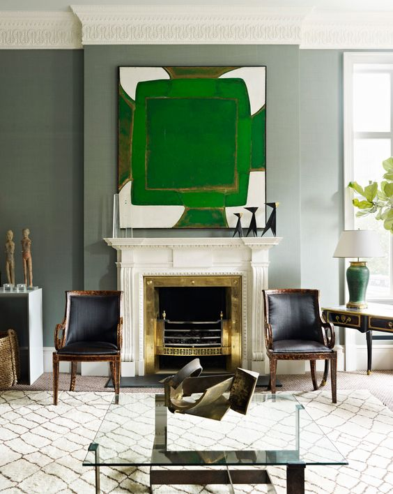 Gray living room walls, traditional fireplace, green modern painting via @thouswellblog