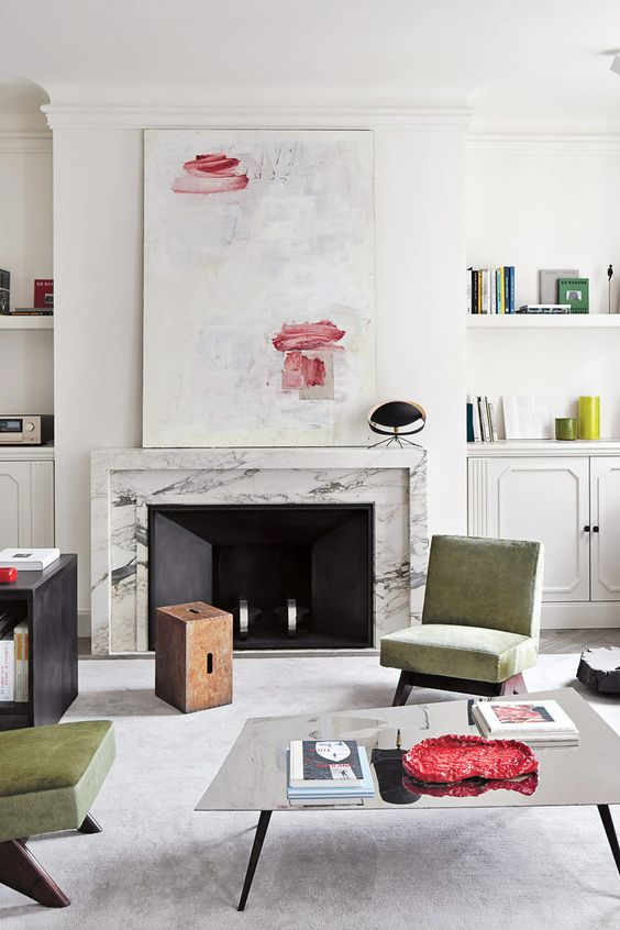 Marble mantel fireplace in minimal French living room via @thouswellblog