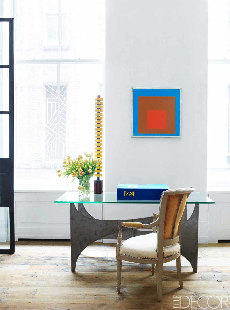 A retro desk with Louis XVI chair and modern art via @thouswellblog
