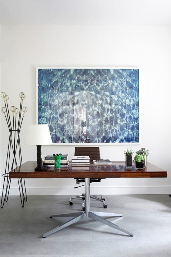 Modern home office with water print above desk on @thouswellblog
