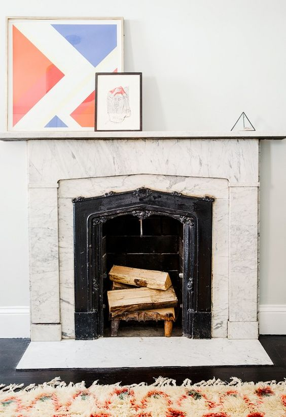 Vintage iron fireplace with marble mantel via @thouswellblog