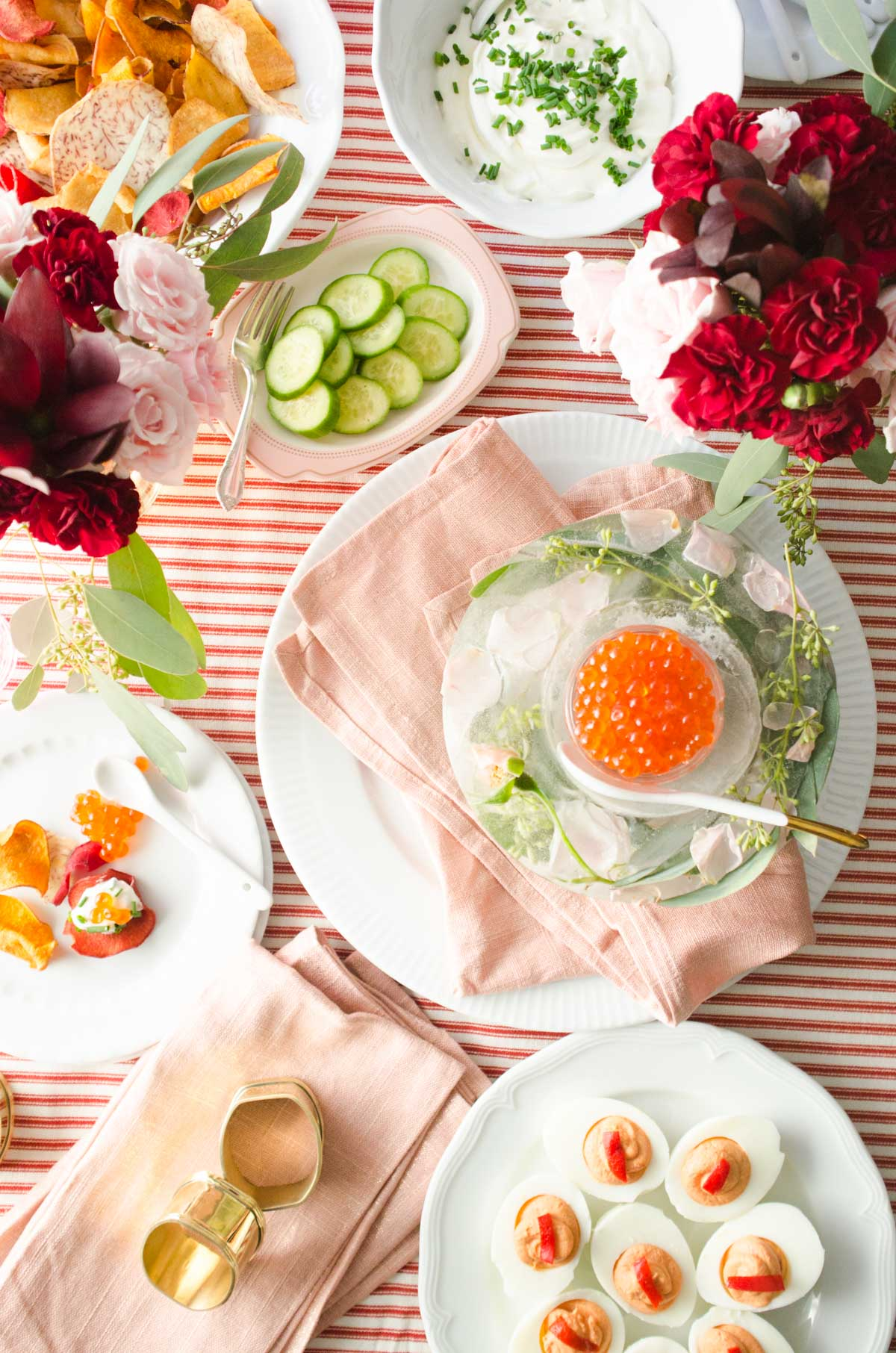 Salmon roe, floral ice bowl, and deviled egg Valentine's Day appetizer party table via @thouswellblog